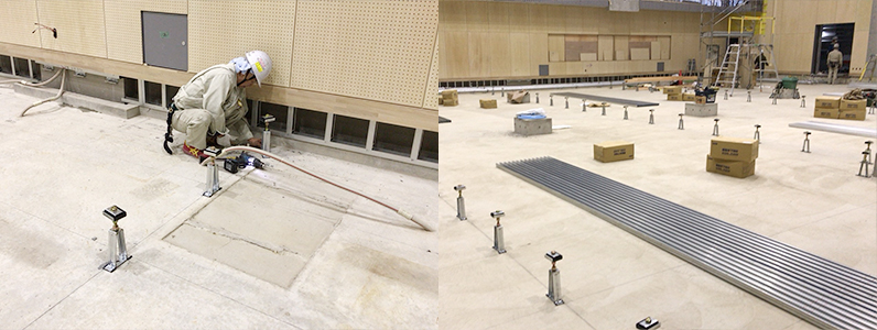 大学キャンパス内体育館新設工事に伴う鋼製床下地支持脚施工