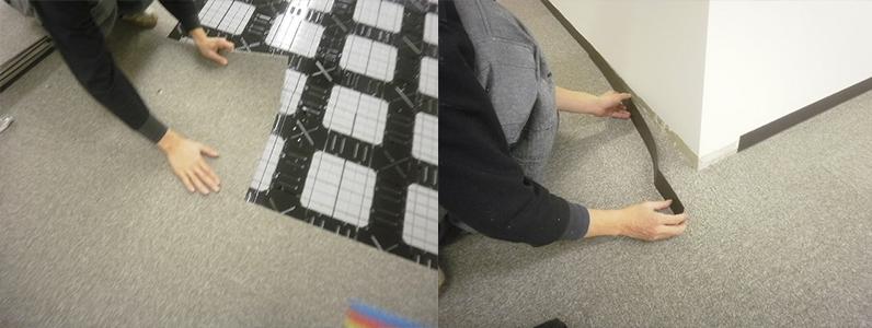 事務所床改修工事、溝配線置き敷式OAフロア施工及びスロープ設置後タイルカーペット貼り巾木取付